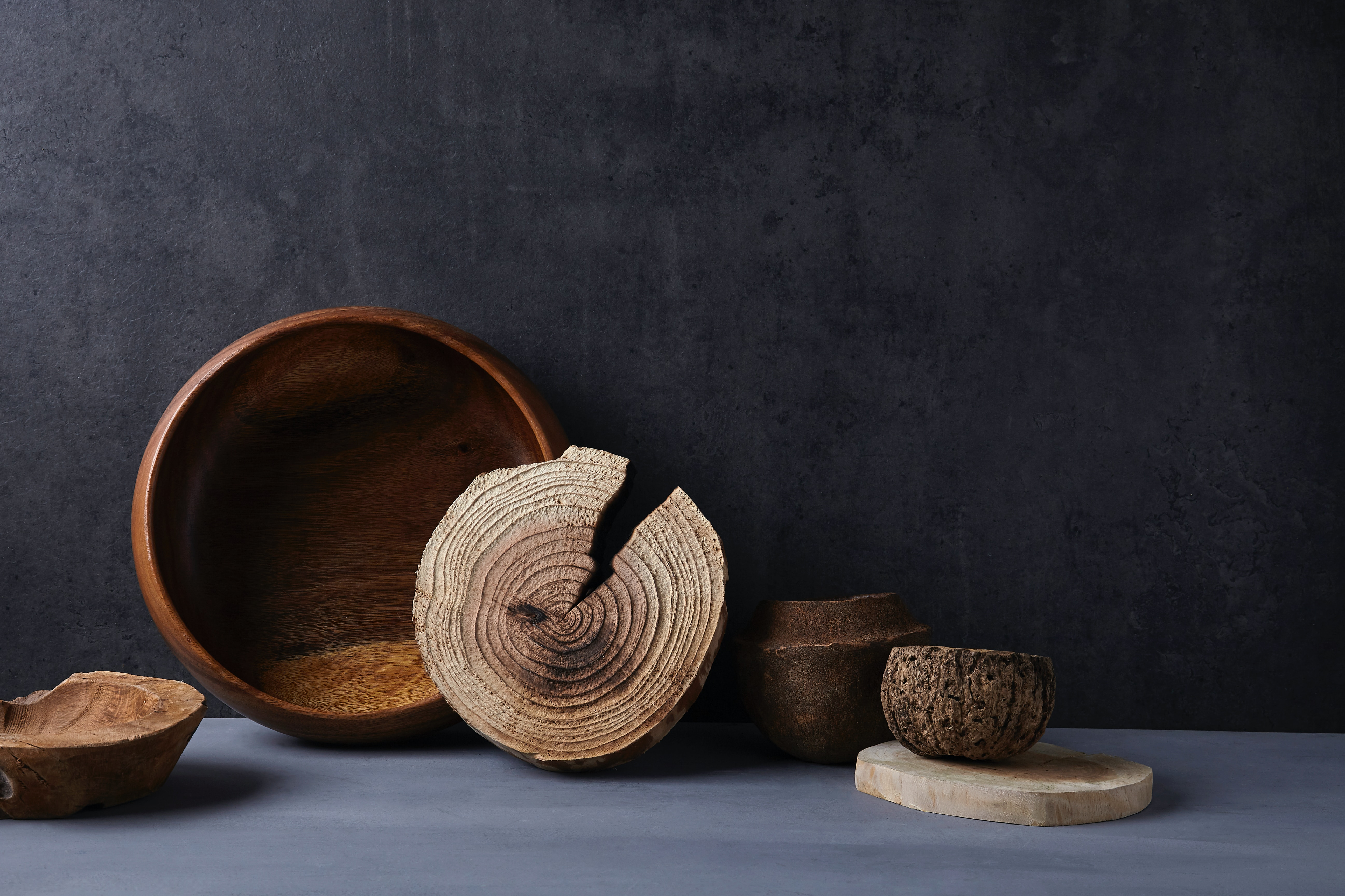 brown wooden round bowl on white table
